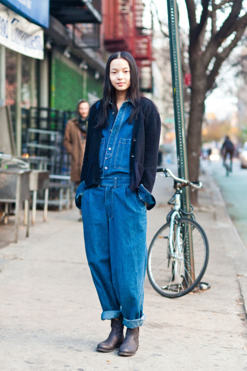 Model Monday!  雎晓雯 (Xiao Wen Ju, IMG Models) on Rivington today.  Perfect denim … overalls ? jumper? Lovely cardigan, rolled cuffs, and comfy boots. Happy December yall! Check out her friend who designs Baby Ghost I wanna be her friend! I got to practice Chinese today! And run into a lot of moving cars, people, and trash cans! But it's alllll worth it : )  www.thenycstreets.com Twitter Facebook