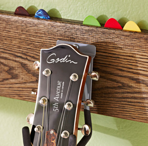 Build a Stylish Guitar Hook in a Day_lowescreativeideas.com This one takes a bit more effort than the vinyl record bracket but I think it is worth it. I especially like the pick storage at the top.