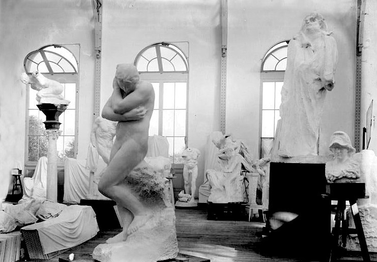 Auguste Rodin's studio with several works including Eve and a large sculpture of  Honoré de Balzac (at center right).