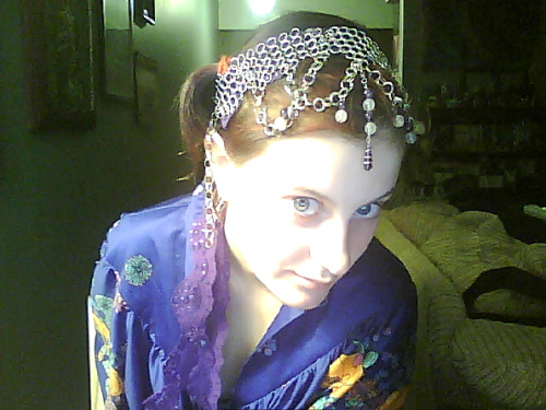 Chainmail and lace headband.  =] Although the chainmail was a gift that broke and I had to put it back together, it makes a better headband than a necklace.  It was always so itchy…  Used some purple lace I've been hanging onto for forever as the tie/backing. Most likely going into my etsy shop.. though the sewing is not the best, so maybe this will be a demo and I'll make more?  Gotta dig out my tools and chain links… Am I the only one who thinks I look elven?  The LOTR kind of elven?
