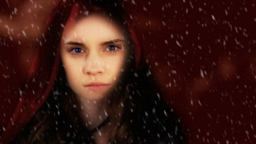 Hermione Granger as red riding hood in snow.