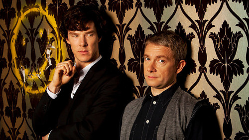 "hedwig-dordt:  pati79:  valeria2067:   sherlockbbc: WAIT ARE THEY.. ARE THEY StaNDING ON THE cOUCH???!  I think they ARE standing on the couch!   In fact, THIS REQUIRES A FICLET! — Sherlock is pacing the floor in front of the sofa, arms flailing, angry comments about incompetent yarders spewing from his lips, his feet nearly stepping on those of a rather amused John Watson. ""Right,"" John huffs. He steps up onto the sofa's leather seat cushion and stands with his back against the wall. Sherlock stops in mid-pace. ""John, what are you doing? ""I'm conducting an experiment, Sherlock."" ""YOU'RE conducting an experiment?  What sort of experiment requires you to stand on our sofa?"" ""Call it a personality test.  Or a test of endurance. For you."" A frown creases Sherlock's brow, and his lips turn down a bit at the corners. ""And just what do you expect to prove, John?"" John smiles and looks away for a moment before meeting Sherlock's eyes again. ""I expect to prove, Sherlock, that you can't even function in the same room with me if I seem taller than you."" Sherlock rolls his eyes. ""How very immature. I thought you were above that, Doctor."" ""Oh, I'm above EVERYTHING right now. It's quite nice, this view."" John laughs and looks at his wristwatch. ""Go on, then. Do your deduction thing. I'll just wait right here, shall I?"" ""You actually think I care about our height?"" John smirks, his tongue filling out one side of his cheek. ""Prove me wrong."" I takes less than six minutes for Sherlock to find himself standing next to John on the couch, directly between his flatmate and a bullet-ridden spray-painted smiley face. John makes a point of saying absolutely nothing. ""Shut up,"" replies Sherlock  That was….   Godtiss, we really need season 3"