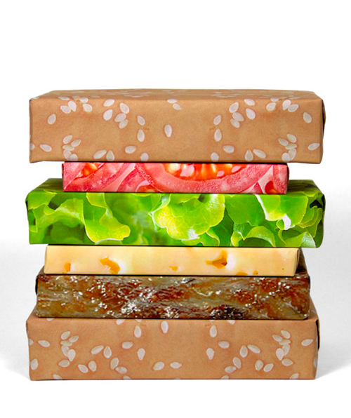 "But seriously… this is amazing.  thedailywhat:  Cheeseburger Wrapping Paper of the Day: Just in time for Christmahanakwanzika, Sarah Fay and Justin Colt's Gift Couture — ""a start-up creative and innovative wrapping paper company"" — introduces the mouth-watering Cheeseburger wrapping paper set. They're still several thousand dollars shy of their Kickstarter goal from making this available to the wrapping public, but, for a pledge of $20 or more (plus $8 for international shipping), they'll send you one complete set of Cheeseburger wrapping paper. $40 gets you 2 complete sets, and $60 gets you 3. $300 gets you 10, plus a ""hand-crafted golden cheeseburger trophy."" Come on. You know you want that trophy. [szymon.]"