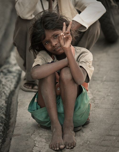 Child beggar by Julien Lagarde on Flickr.