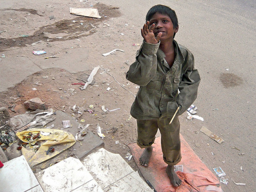 A child in the street, New Delhi by LLudo on Flickr.