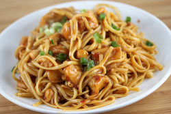 prettygirlfood:  Kung Pao Linguini Recipe Ingredients:1lb boneless skinless chicken breasts½ cup cornstarchoil (for deep frying)1lb uncooked linguini noodlesSauce-½ cup chicken broth2 tablespoons cornstarch¾ cup soy sauce½ cup dry sherry3 tablespoons red chili paste with garlic¼ cup sugar2 tablespoons red wine vinegar1 tablespoon sesame oil¼ cup garlic (minced)1 cup dry roasted peanuts1 cup dry roasted peanuts1 cup green onions (sliced) Cooking Instructions: Step 1: Bring a large pot of salted water to a boil, add linguini and cook according to package directions. When linguini has finished cooking drain and set aside.Step 2: While noodles are cooking, toss cut up chicken pieces with ½ cup of cornstarch until evenly coated.  Heat oil in a deep fryer to 375 degrees. Deep fry chicken bits in batches until golden brown and fully cooked (the internal temperature has reached 165 degrees). Drain on paper towels.Step 3: In a bowl whisk together chicken broth, 2 tablespoons of cornstarch, soy sauce, dry sherry, red chili paste with garlic, sugar, red wine vinegar, and sesame oil.Step 4: Heat 2 tablespoons of vegetable oil in a wok or fry pan over medium-high heat. Add garlic and stir fry for 15 seconds. Pour the sauce mixture into the pan. Stir in peanuts. Bring to a boil, reduce heat and simmer until thickened and bubbly.Step 5: In a serving bowl add cooked linguini and chicken bits. Add the kung pao sauce mixture.  Add green onions and toss everything together.(Makes 4 Servings)