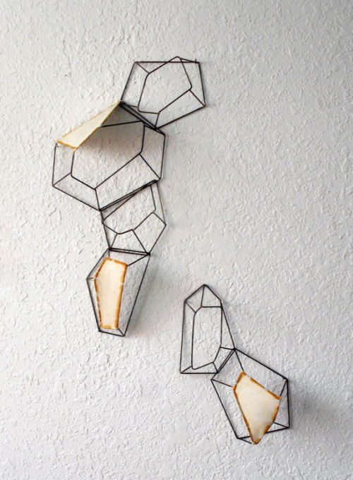 Steel and abaca paper by artist Sarah West via her shop.