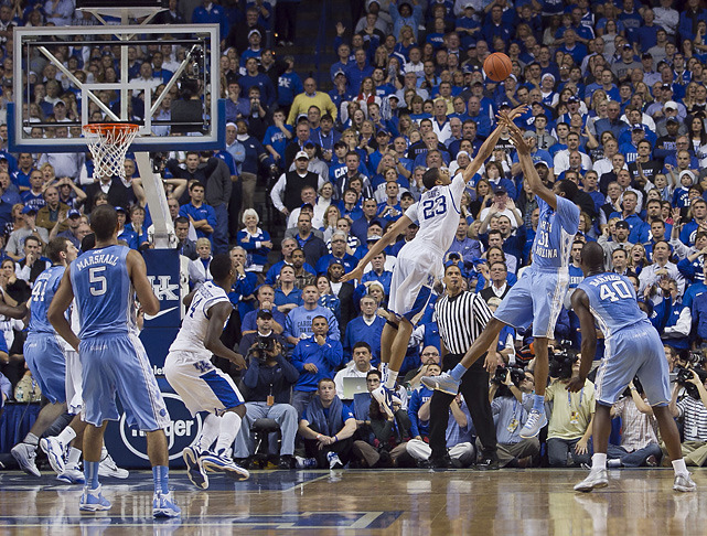 Kentucky's Anthony Davis blocks a shot attempt by UNC's John Henson Saturday's Tar Heels-Wildcats game at Rupp Arena. The blocked shot secured a Kentucky win, 73-72. (Robert Willett/ZUMAPRESS.com) DAVIS: UNC-Kentucky provided an early taste of March in DecemberGALLERY: Iconic photos of Kentucky Basketball