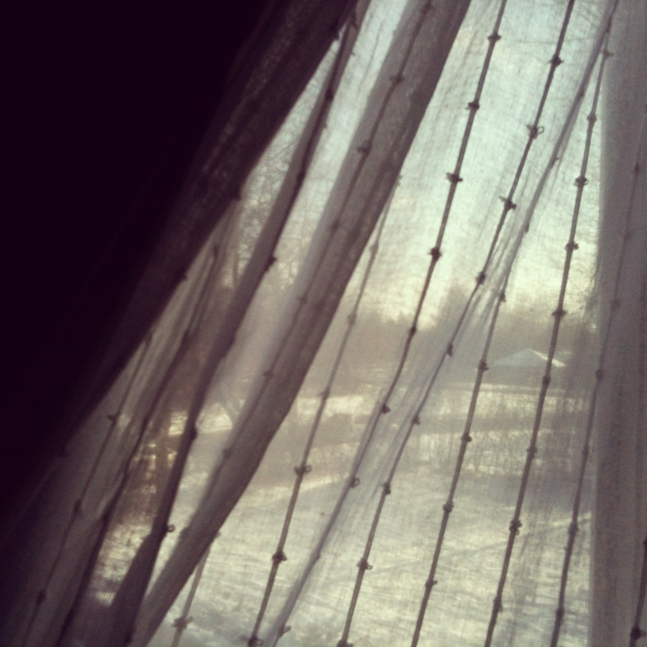 Gift of the Ordinary #2 The soothing shade of curtains drawn. The light softens, transforms the room into a bluish early morning gray. And my eyes can relax, the stress clenching my mind ease as the tiredness of this world is shut out by the simple draping of a cloth.