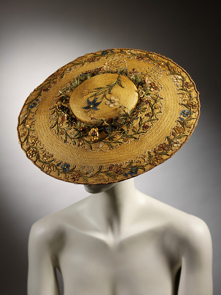 ornamentedbeing: The V&A says ~ Round, flat straw hat with shallow crown. Embroidered with straw-work flowers on crown and around brim; wreath of straw flowers around crown. Yes, please :)