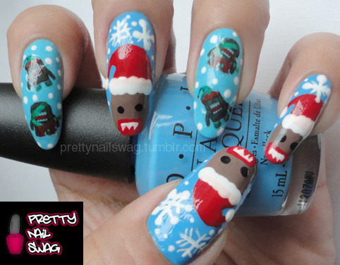 My Christmas Domo Nails…water decals on my index and ring fingers, freehanded the rest, please don't mind the shitty-ass lighting and how I butchered poor little Domo's teeth :P