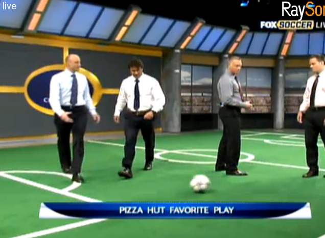 "fox soccer is displaying their ""pizza hut favorite play"" NOT by taking advantage of the high-def slo-mo replay technology available from their dozens of cameras stationed all around and above the field that capture each event from a wide variety of angles, but by having a bunch of middle-aged men stand on a tiny green-screen soccer field and slowly, with lots of talking, perform their clumsy version of said play. a difficult choice but, i believe, the correct one."