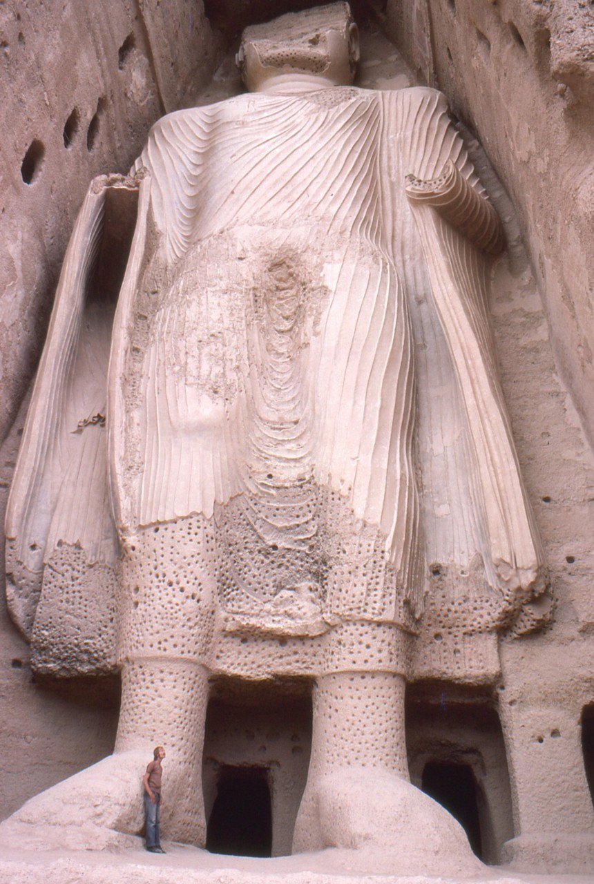 "watanafghanistan:  Facts about Bamiyan & the Buddhas The Buddha was built some time between the third and fifth centuries. It was 57 meters high ( the hight of a 20 story building). There are total of three colossal statues carved 4,000 feet apart. At one time, two thousand monks meditated in caves among the sandstone cliffs. The world's earliest oil paintings have been discovered in caves behind the partially destroyed colossal statues. Scientists from the European Synchrotron Radiation Facility have confirmed that the oil paintings, probably of either walnut or poppy seed oil, are present in 12 of the 50 caves dating from the 5th to 9th century. Ironically Buddhism was also a religion that abhorred idols. Over 2000 years ago, the Buddha was represented by a symbol usually a foot print or a wheel. But then great change in Buddhism took place and it took place in Afghanistan. Those who ruled Bamyan lunched a new humanized form of Buddhism by turning a Buddha into a recognizable form. Afghanistan was the place where the Buddha in a human form was taken to the world.  Before being blown up in 2001 they were the largest examples of standing Buddha carvings in the world (the 8th century Leshan Giant Buddha is taller,  but the statue is sitting). The whole mountain surrounding the Buddha, is full of tunnels and it all leads to little chambers which the monks would have lived in and prayed in. The top of the Buddha's face had been carved off and burned, by zealotry of Aurangzeb's soldiers in the 18th century. A monk from Korea, Huichao (727 C.E. ) describes Bamiyan as an independent Buddhist state. In Bamiyan, as elsewhere in Central Asia, apocalypse came at the hands of Ghengis Khan in 1221 C.E. Ghengis sent a small army to seize the valley, commanded by his favorite grandson. When the boy was killed by a bowshot from the fortress of Shahr-i-Zohak ( the Red City), the Khan vowed implacable revenge: no human or animal would be allowed to live. As always in these matters, Ghengis Khan was true to his word. Neither the city of Bamiyan nor its outliers were ever rebuilt; their ruins stand today as mute testimony to the human capacity for savagery. The statues represented the classic blended style of Gandhara art. Bamiyan is known as city of Screams. Now silent, it was once filled with screams of the thousands of people killed there by Ganges khan. It was a Buddhist religious site from the 2nd century up to the time of the Islamic invasion in the 9th century. Monks at the monasteries lived as hermits in small caves carved into the side of the Bamiyan cliffs. Many of these monks embellished their caves with religious statuary and elaborate, brightly colored frescoes. The two most prominent statues were the giant standing Buddhas Vairocana and Sakyamuni. The Chinese Buddhist pilgrim Xuanzang passed through the area around 630, and described Bamiyan in the Da Tang Xiyu Ji as a flourishing Buddhist center ""with more than ten monasteries and more than a thousand monks"". He also noted that both Buddha figures were ""decorated with gold and fine jewels""  The enormous statues,the male Salsal (""light shines through the universe"") and the (smaller) female Shamama (""Queen Mother"")as they were called by the locals. The Government of Japan and several other organizations, among them the Afghanistan Institute in Bubendorf, Switzerland, along with the ETH in Zurich, have committed to rebuilding, perhaps by anastylosis, the two largest Buddhas. On 8 September 2008 archeologists searching for a legendary 300-metre statue at the site of the already dynamited Buddhas announced the discovery of an unknown 19-metre (62-foot) reclining Buddha, a pose representing Buddha's passage into nirvana source: [1] [2] [3] [4]"