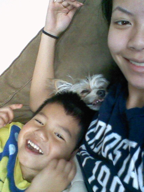 Jayden and I are smiling and so is the dog (: