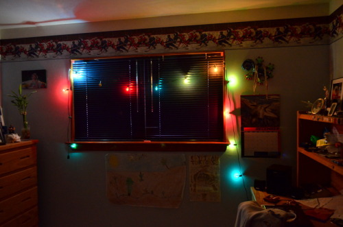 my room, last updated: like never. added these christmas lights before my dad took them away </3 the desert posters are from grade 4, don't hate! :)
