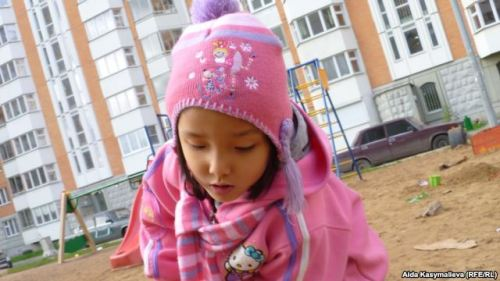 First Person: Life In Russia As A Non-Russian Child Aida Kasymalieva reports from Moscow for RFE/RL's Kyrgyz Service. This summer, she brought her 5-year-old daughter, Bermet, to Moscow from the Kyrgyz capital, Bishkek, where she had been living with her grandparents. This is Kasymalieva's account of her daughter's experience of life in Russia. …On that day we went home and I grabbed Emma — a doll that I had bought in New York City. Emma is an African-American doll, made of cloth, with dark, curly hair, and the same height as Bermet.And the three of us — Emma, Bermet, and I — took a walk in the Field of Miracles. It was our kind of silent protest in support of tolerance and against xenophobia… Read the rest of Aida Kasymalieva's compelling account of her daughter's experience of life in Russia.