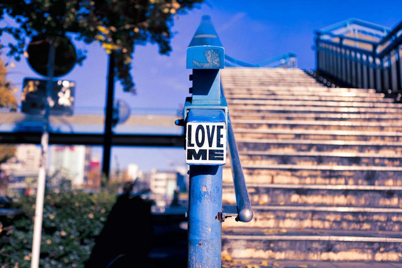 """Love Me"" street sticker in Harajuku."