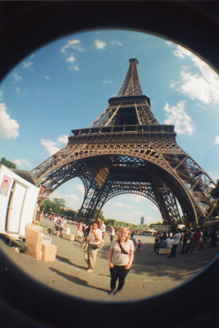 Fisheye Paris.  Made with a Lomography Fisheye No.2 camera. That little dwarf in front of the Eiffeltower is me :P