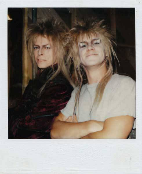 kittydoom:  David Bowie and his stunt double, Nick Gillard, on the set of Labyrinth (1986)  Is that Merlin Mann working as a David Bowie stunt double? Boy does he EVER have a crazy resume!