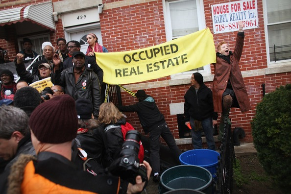 "Bag's Take-Away:  Babel Realty. How perfect is that?  Slideshow : Occupy Movement Organizes Day Of Action Against Foreclosures In Multiple Cities (Zimbio).  (photo: Spencer Platt/Getty Images caption: Community activists and over two hundred members of the Occupy Wall Street movement rally around a forclosed home during a march in the impoverished community of East New York to draw attention to foreclosed homes in the community on December 6, 2011 in the Brooklyn borough of New York City. The group said they would occupy a home and would hand the property over to a homeless family. In what organizers are describing as a ""new frontier"" for the movement, thousands of other Occupy Wall street protesters around the country participated in similar actions.) ————— Topping LIFE.com's 2011 list of Best Photo Blogs, follow us at: BagNewsNotes; BAG Twitter; BAG Facebook; Bag by Email."