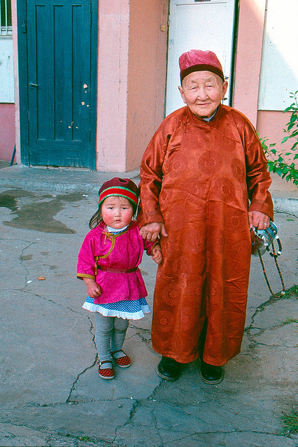 MGA 1991-001-S35 on Flickr. A Mongolian elder and his granddaughter pose for a picture.