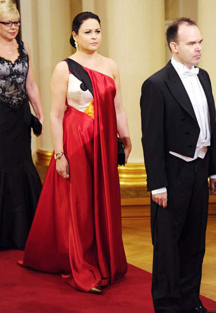 imwithkanye:  Angry Bird Couture Teija Vesterbacka, the wife of Peter Vesterbacka, head of Rovio — the company behind Angry Birds — at a formal event at the Finnish Palace to celebrate the country's independence. [via]  The greatest fashion statement involving a bird since Bjork's swan song.