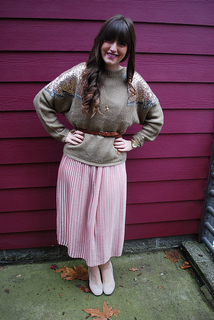 I sparkle in chunky sweaters, sequins, pleats, and lipstick that matches my apartment walls.    How do you sparkle? Submit a photo/description and you may be featured on out Tumblr!  http://theglitterguide.tumblr.com/submit