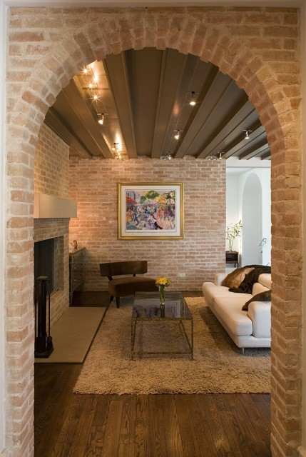 A beautiful room with brick walls, fireplace, and a brick archway (via Bridlepath Interior - contemporary - living room - austin - by Hugh Jefferson Randolph Architects)