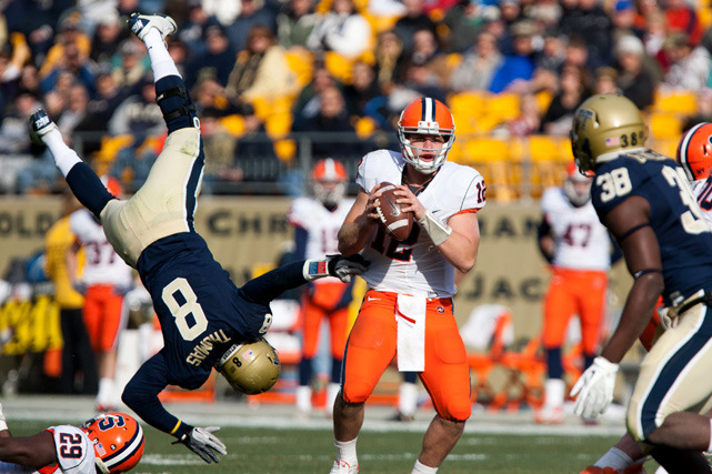 Pittsburgh linebacker Todd Thomas goes airborne over Syracuse running back Antwon Bailey as he pressures quarterback Ryan Nassib Saturday's Orange-Panthers game.   (ZUMAPRESS.com) MANDEL: BCS title game rematch headlines bowl rankings