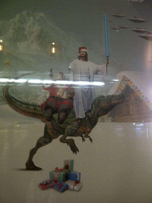 captaingreythewolf:  jesus with a lightsaber and santa riding a trex saw this in like a shoe shop window  my life is complete