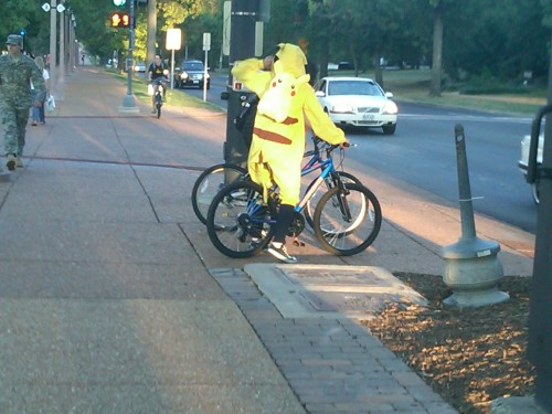 A pikachu person wearing a pikachu backpack. All he needs is a pikachu bicycle to achieve Pika-ception.  (Note: The submitter of this picture assures us that this was not taken on Halloween. We're pretty dumb here, so we'll probably believe anything you submitters tell us.)
