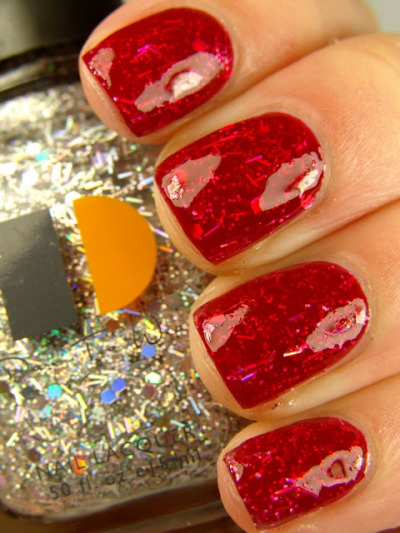 Nails count as something you'd wear, right? Check out this awesome nail design from: http://steffels.blogspot.com/2011/09/some-red-spam.html It's a coat of red, then a coat of glitter, and then another coat of red. Red, glitter, red - got it? This manicure combines two of my favorite things: 1. Red, the hottest color ever. 2. Glitter - I don't think I need to talk about how much I love glitter. Yep. I'd wear that (and I JUST might tomorrow!)