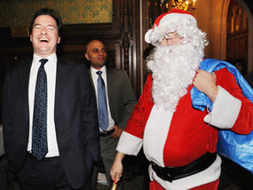 weirdcelebcrushes:George with Ed Balls dressed as Santa