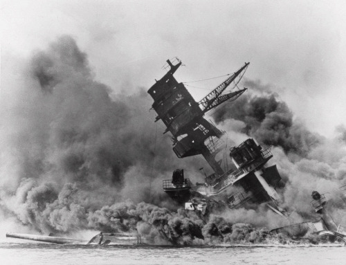 Today is the seventieth anniversary of the attack on Pearl Harbor during World War II. The Big Picture has a gallery of portraits of survivors, shots from ceremonies held in the past few days, and eleven photos taken the day of the attack. The above photo, from the Associated Press, is of the USS Arizona collapsing into the sea. The whole set is definitely worth checking out.