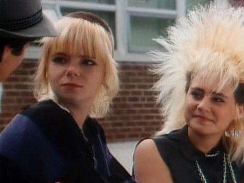 sexistappeal:  [Image: Still from an episode of Degrassi Junior High showing Liz and Spike looking toward the left side of the frame at Joey with amusement.] Pretty much watching episodes of DJH for the sole purpose of seeing these two fierce grrls together.