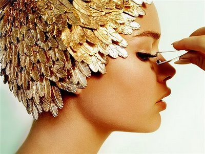 Gold Feather HeaddressPhotographer: Mario Testino