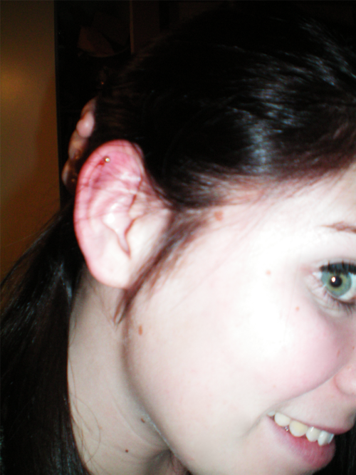 aside from my hair being icky and too dark, i got my ear pierced (:<