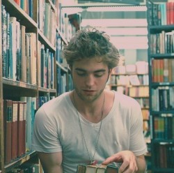 "Robert Pattinson: ""If you find a girl who reads, keep her close. When you find her up at 2 AM clutching a book to her chest and weeping, make her a cup of tea and hold her. You may lose her for a couple of hours but she will always come back to you. She'll talk as if the characters in the book are real, because for a while, they always are. Date a girl who reads because you deserve it. You deserve a girl who can give you the most colorful life imaginable. If you can only give her monotony, and stale hours and half-baked proposals, then you're better off alone. If you want the world and the worlds beyond it, date a girl who reads."""