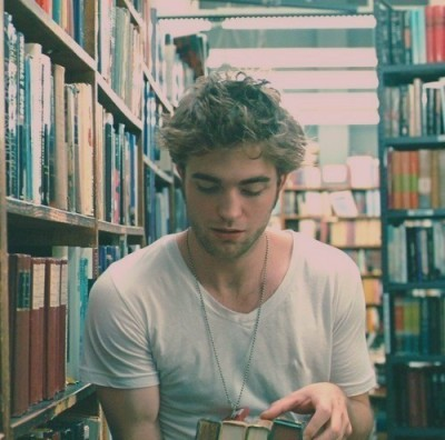 "Robert Pattinson:""If you find a girl who reads, keep her close. When you find her up at 2 AM clutching a book to her chest and weeping, make her a cup of tea and hold her. You may lose her for a couple of hours but she will always come back to you. She'll talk as if the characters in the book are real, because for a while, they always are. Date a girl who reads because you deserve it. You deserve a girl who can give you the most colorful life imaginable. If you can only give her monotony, and stale hours and half-baked proposals, then you're better off alone. If you want the world and the worlds beyond it, date a girl who reads."" Brandon Hall:""The reason girls cant find a good guy is because they look in the wrong places, go to a library. Guys at a party are just looking for the next girl to fuck."""