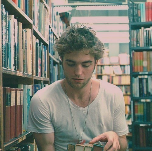"Robert Pattinson: ""If you find a girl who reads, keep her close. When you find her up at 2 AM clutching a book to her chest and weeping, make her a cup of tea and hold her. You may lose her for a couple of hours but she will always come back to you. She'll talk as if the characters in the book are real, because for a while, they always are. Date a girl who reads because you deserve it. You deserve a girl who can give you the most colorful life imaginable. If you can only give her monotony, and stale hours and half-baked proposals, then you're better off alone. If you want the world and the worlds beyond it, date a girl who reads."" Brandon Hall: ""The reason girls cant find a good guy is because they look in the wrong places, go to a library. Guys at a party are just looking for the next girl to fuck."""