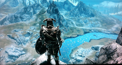 "ELDER SCROLLS V: SKYRIM [game] Review Alright, I've been able to play for a couple days now, I feel like I have a justified view of the game. First things first; why is this such a popular game with…everyone! I'm seeing memes posted from the most unlikely sort. I hate to be one of those dorks to say it, but is it popular just because it's popular? Have any of these people played any of the other ES games? /rant Let's start, at the beginning. The intro, while intense, I felt was too fast paced. Like Oblivion you're a prisoner who gets thrown into battle. However there comes that point where you eventually have to head off on your own. In Skyrim I felt like when that time came, it was too open ended. I didn't know enough about the history of the game to make any evaluations as to what I should do next. Oblivion did a great job of telling you about the history of Tamriel, thereby helping you understand your own character. Gameplay wise, it's great. They simplified it enough that the button layout works smoothly. And I love that instead of choosing a Class, you can go to different shrines to imbue yourself with Class Blessings (I used to spend hours in 3+4 choosing the ""right"" class). I like the cue from other games that involve jobs/tasks aside from quests. Smithing, skinning, metalworking, all great time fillers for the game. Before, you'd collect troves of useless items that now have a purpose! Also, you can definitely tell Bethesda took what they learned from Fallout3 and applied it to this game. Fighting is still pretty much the same. The new magic/shouts are so much fun, and you really have to work at your blocking…I've never been into archery in ES games :P And there is no better feeling than standing on the edge of a cliff with a dragon circling you overhead; axe in hand, destruction magic at the ready, shouting a battle cry and readying yourself for the onslaught that's about to happen! As with Morrowind and Oblivion I really need to explore the entire map before I feel like I've made it anywhere in the game. My only complaint is that it feels like this game is smaller than the last. Almost as if they knew they wanted a wider audience so they pulled a Blizzard and simplified their game too much. Disclaimer: Be ready for hours of exploring and talking with NPC's, and if you don't even know what that means just put the game down…If you haven't played Morrowind or Oblivion then this game won't make sense to you. And don't talk to me about it if you're one of those people that started with this game, that's like starting with Halo 3 because of the multiplayer and talking about it like you know Halo. If you're into RPG, fantasy, dragons, vikings, Elder Scrolls…definitely pick this up! I play a Nord / Warrior"