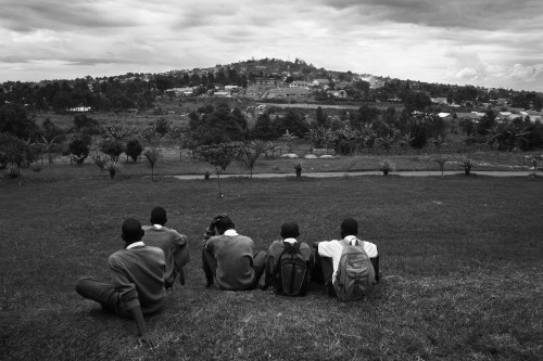School children hanging out on school grounds after class, Uganda.  Photography by Bryan Anselm