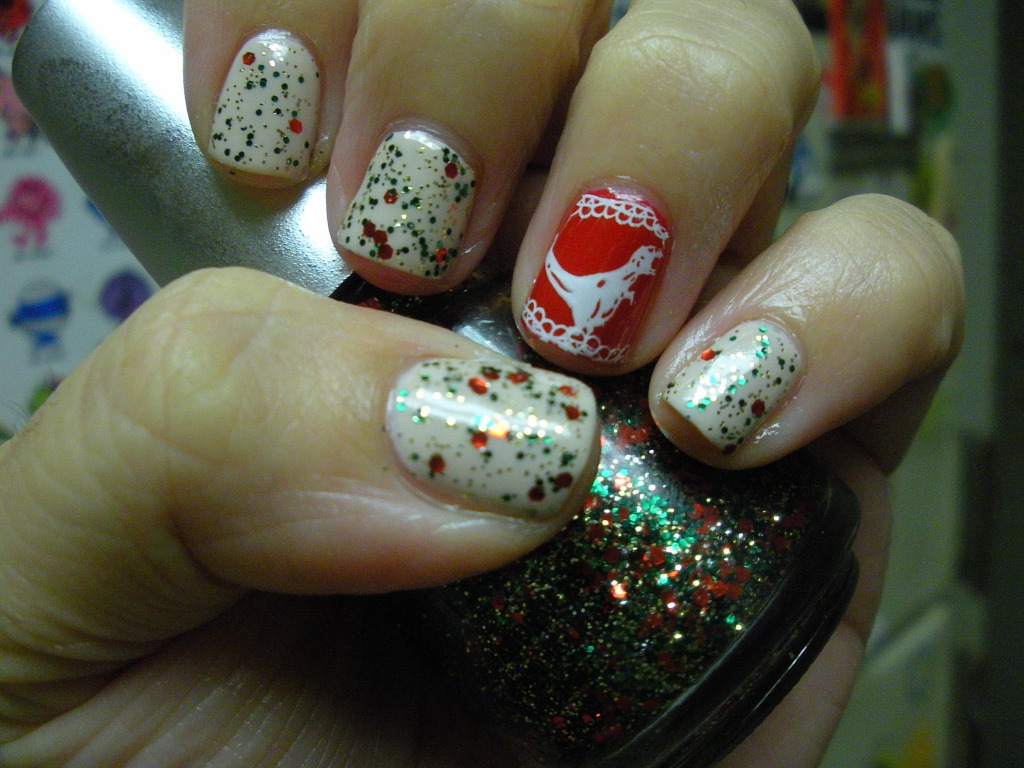 Tyrannosaurus Rex-mas sweater OPI Let Them Eat Rice Cake, OPI Big Apple Red, China Glaze Party Hearty and hot topic stamp plate