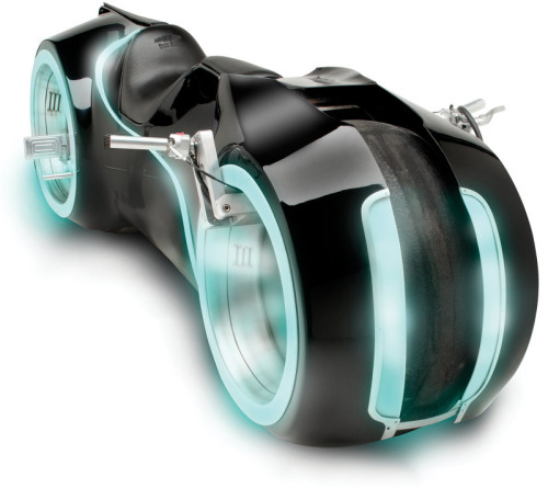 "The TRON light cycle is now a reality and looking damn good. If you have $55,000 to drop, this beast could be yours. Available now at Hammacher Schlemmer. Check out the videos below to see it in action, User!  ""This is the illuminated, street-legal motorcycle inspired by the computer animated cycle from the 2010 film Tron: Legacy. Designed for casual cruising and slow ride-bys at shows, it is made from a steel frame covered by a fiberglass cowling that replicates the sleek look of its computer-generated imagery counterpart.""  The Light Cycle at Hammacher Schlemmer (Facebook) Via: Discovery"