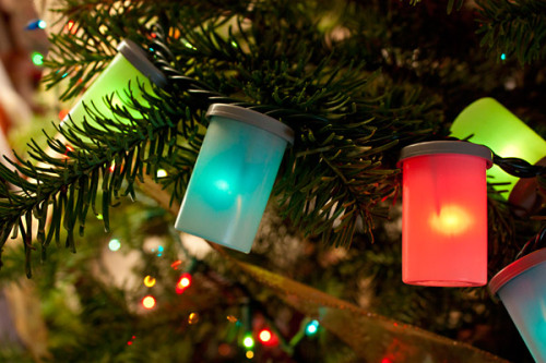 photojojo:  DIY: Recycle Your Film Canisters into Holiday Lights Turn all those film canisters you've saved up (or pick some up from a local lab) into a string of Holiday lights! Because it's just not the Holidays until you've added a dose of photo-geek. Project inspired by Sarah MacFarlane