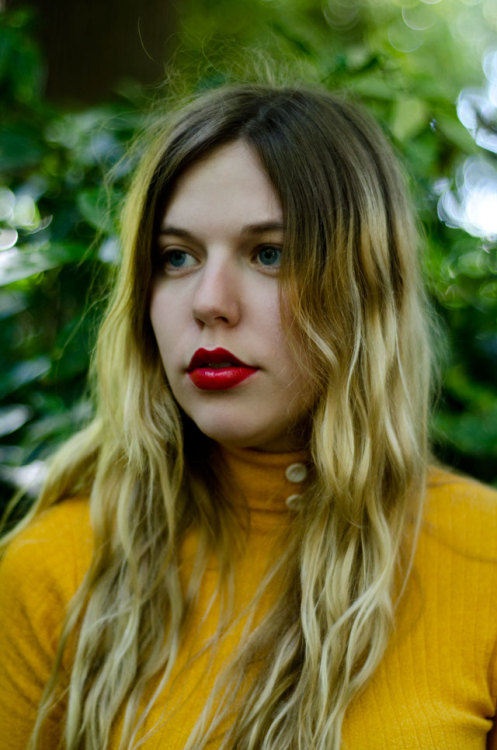 We love the way a bright red lip pops against this mustard hue. Jo of Lost In The Haze.