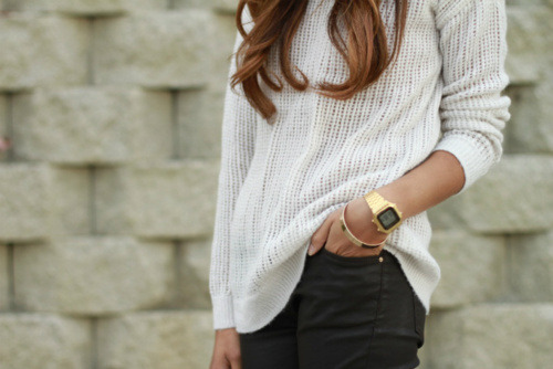 I love her watch and sweater!