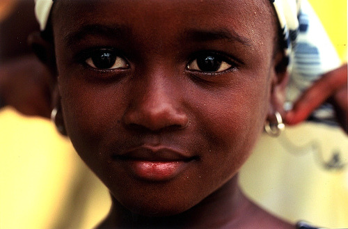 A Ghanian child, one of the seven countries we have sent food to, as well as  The Dominican Republic El Salvador Guatemala Haiti India Kenya