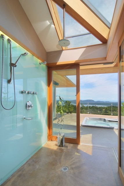 A massive walk-through shower room, enclosed with glass walls and ceiling, leads outside to a whirlpool tub on the terrace (via DigitalProperties.ca)