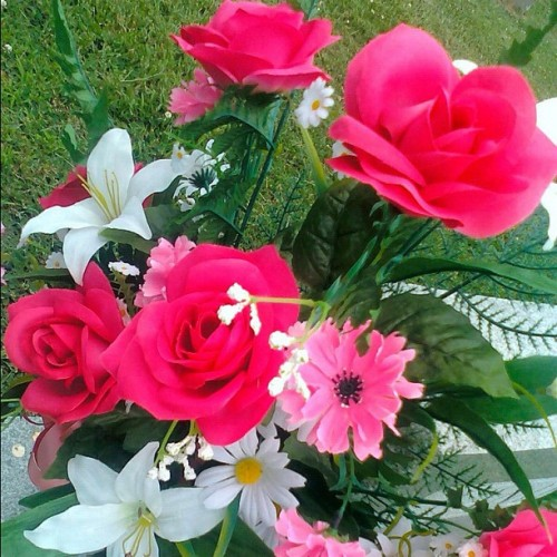Gorgeous faux flowers on my great-grandparents grave. #flowers #pink #white #red #fauxflowers #pretty #cemetery #graveyard #tombstone (Taken with instagram)
